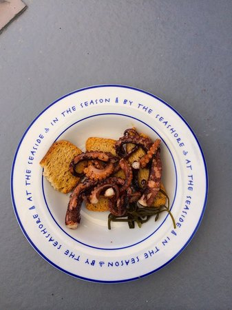 Arc Houses: Breakfast octopus cooked on our stove and eaten on the matching plates on our verandah