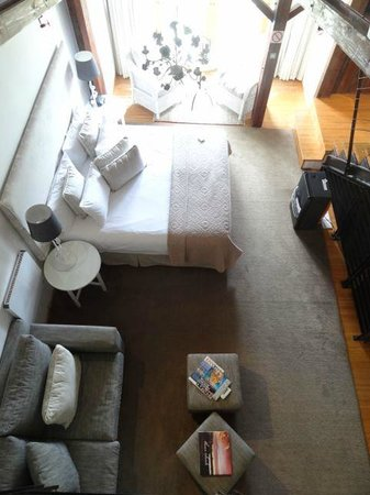 The Lofts Boutique Hotel : The view looking down from the second level (two bedroom apartment).