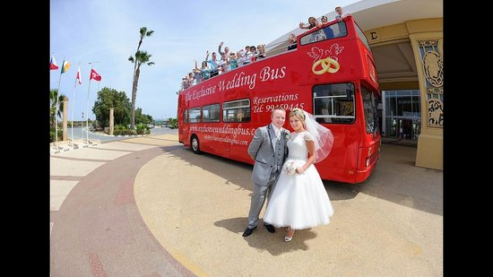 Olympic Lagoon Resort: The Big Red Wedding bus at the front of the hotel