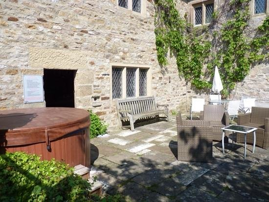 Harthill Hall Holiday Cottages: the private back garden with hot tub at The Manor House