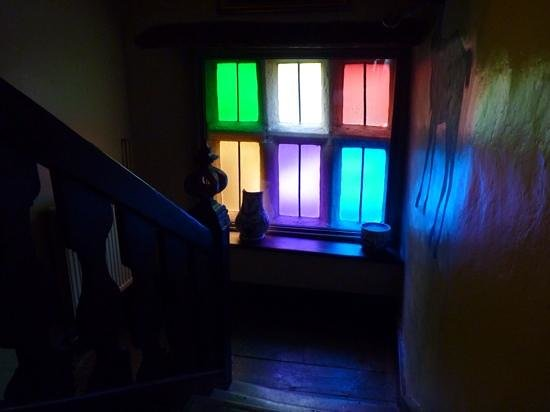 Harthill Hall Holiday Cottages: the colourful window on the landing inside The Manor House