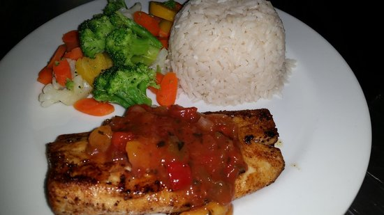 Harvey's: Blackened Mahi Mahi topped with Mango Salsa served with Coconut Rice & Vegetables