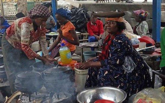 Katutura Township: A herero woman selling 'pap' (maize porridge)