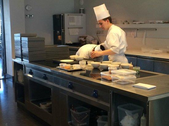 Geranium : Watching the chefs at work while enjoying dessert in the kitchen.