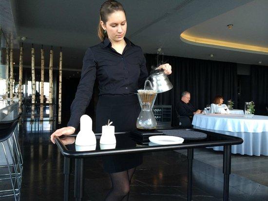 Geranium : Our server preparing our imported coffee