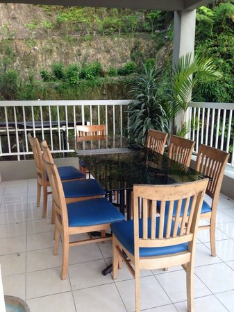 Father's Guest House: Balcony with sitting area. Great place to have your afternoon coffee