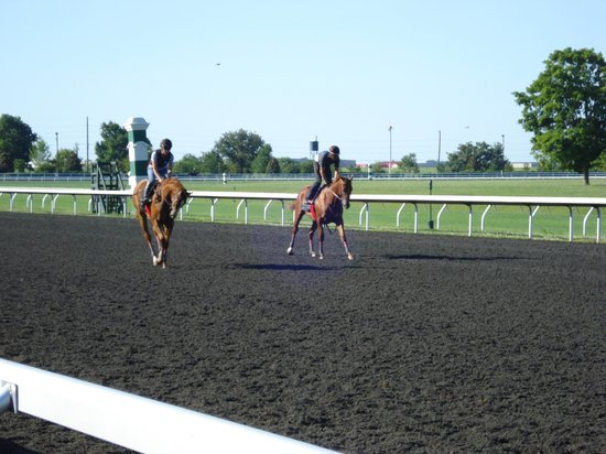Keeneland: Riders on the track.