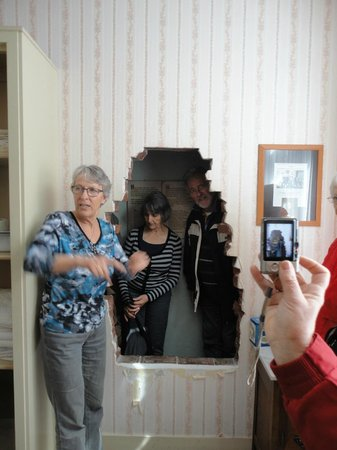 The Corrie ten Boom House: The brick wall removed to reveal the Hiding Place.