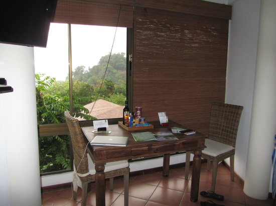 Tulemar Bungalows & Villas: eating area with picture window. Example of blinds