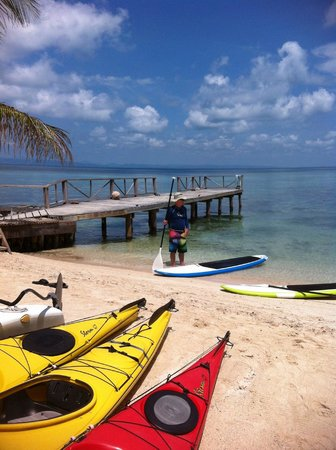 Thatch Caye, a Muy'Ono Resort : Kayaks, paddle boards near the pier.