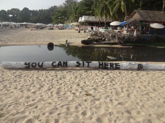 Surin Beach: Black water on the beach, waiting to be carried into the ocean