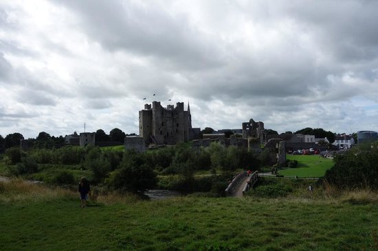 View of the Trim Castle up the slope to yellow Steeple