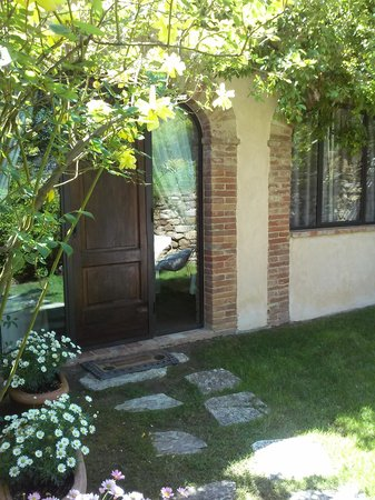 Villa Cicolina: Our room's front door with private patio.
