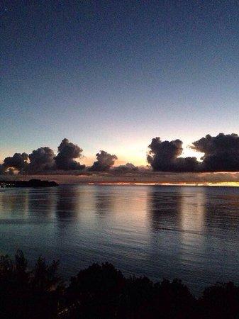 Guam Reef & Olive Spa Resort: Закат с балкона башня инфинити