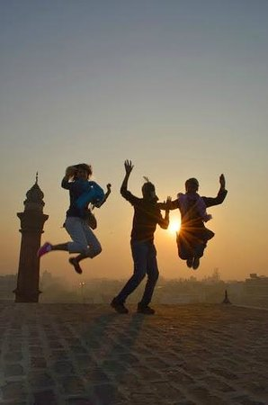 Old Delhi Bazaar Walk & Haveli Visit : Our guide took a fun photo of us as the sun rose on a roof top in Old Dehli