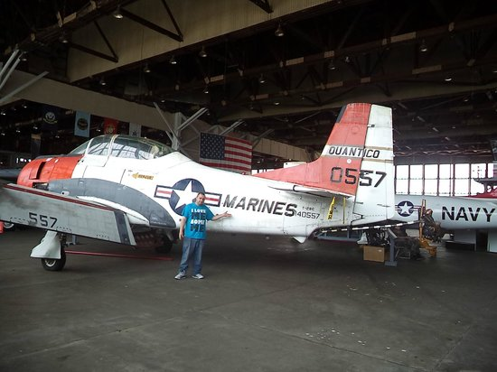 Naval Air Station Wildwood Aviation Museum: My fiance....looks so little next to the plane