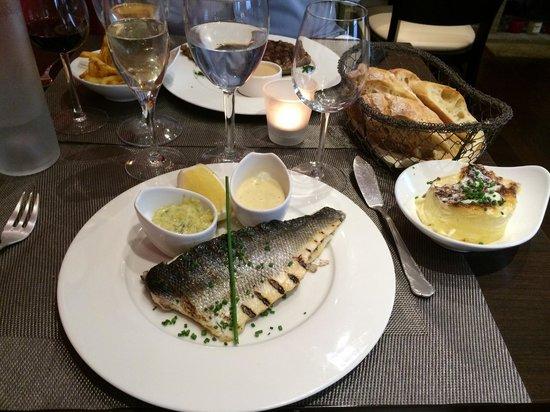 La Petite Tour : Our main course - grilled sea bass, gratin dauphinois, fresh bread, Black Angus steak, fries