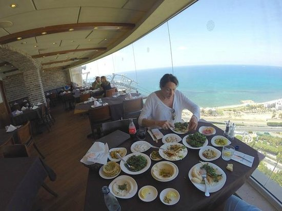 Shawatina: salad selection with Haifa in the background