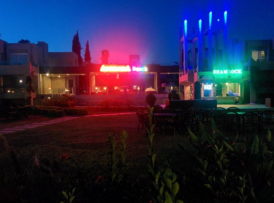 Ambrosia Hotel: hotel from the beach at night