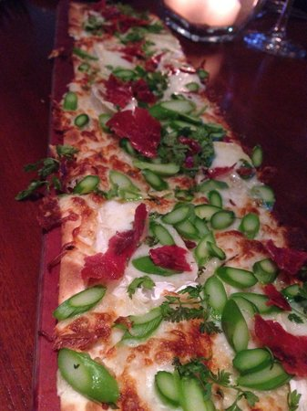 Seasons 52: Prosciutto and asparagus flatbread with Camembert cheese.