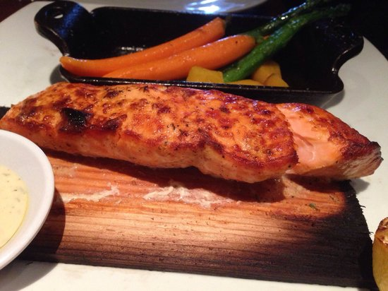 Seasons 52: Cedar Plank Roasted Salmon roasted vegetables, crushed potatoes, dill-mustard sauce, grilled lem