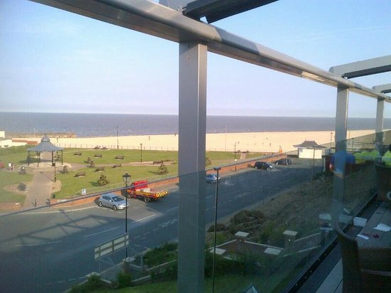 The Cliff Hotel: View from the veranda overlooking the beach
