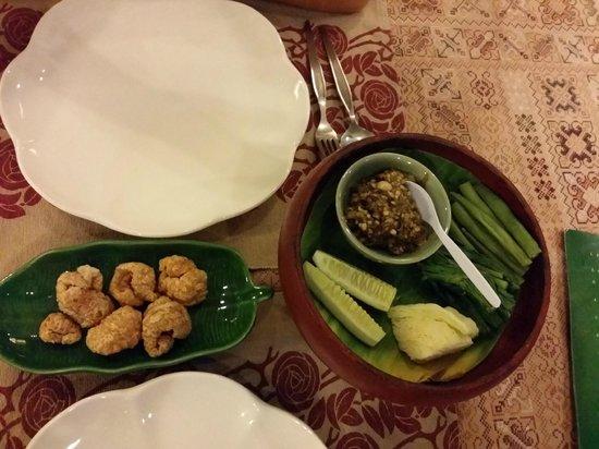 Huen Phen: Pork Skin fried to a crisp. Goes with firey hot relish.