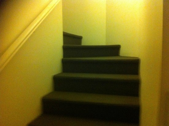Regency Apartments: The staircase that leads to the upstairs rooms in the unit