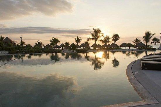 Secrets Maroma Beach Riviera Cancun: sunrise over the pool