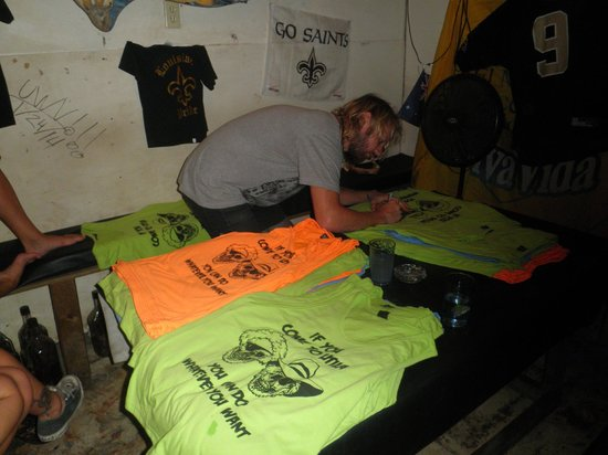 Skid Row's : Ginski signing shirts at the Skid Row Bar Utila