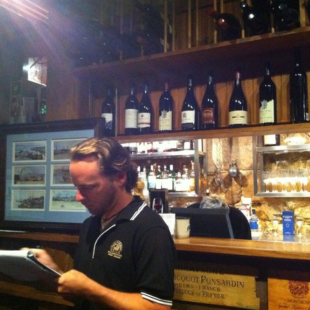 Ball and Chain Grill : Bar counter and one of this service staff