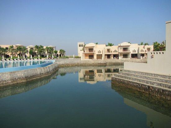 The Cove Rotana Resort Ras Al Khaimah: On a bridge looking towards pool and villas