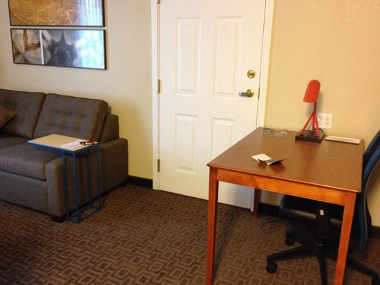 TownePlace Suites Salt Lake City Layton : Desk and couch - USB port on desk lamp