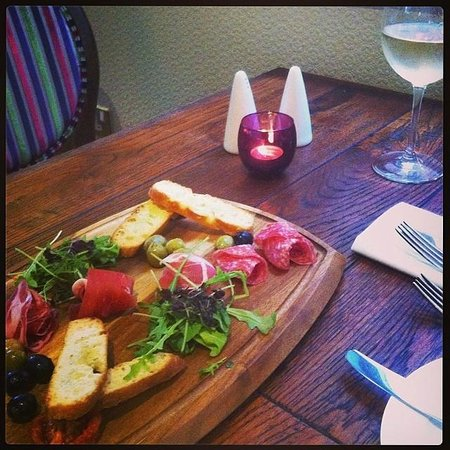 Starter - Antipasti platter for two: A selection of cured meats, crostini, olives and sundried t