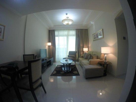 Adamo Hotel Apartments : salon appartement 1 chambre