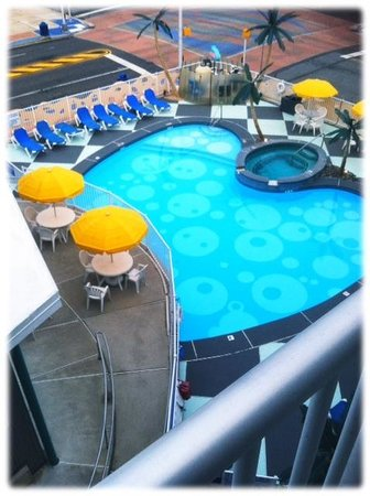 The StarLux Hotel & Suites: Pool and Lounge area with Hot Tub and outdoor BBQ