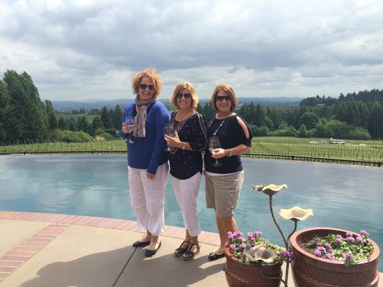 A Great Oregon Wine Tour: Enjoying wine by the winery owner's pool.  Look at the view in the background!