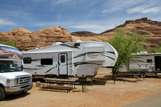 Goulding's Lodge & Campground: Site 16 (the big Rockwood trailer) with a view of the canyon wall behind it