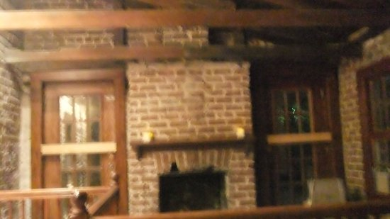Sorrel Weed House: Shadow of a man watching behind the door