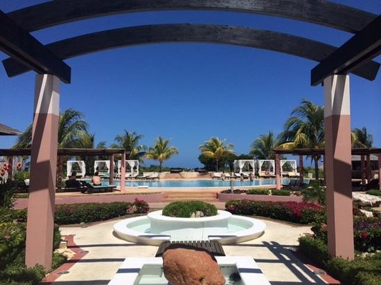 Melia Buenavista: Stepping through Lobby looking towards ocen over one of the pools