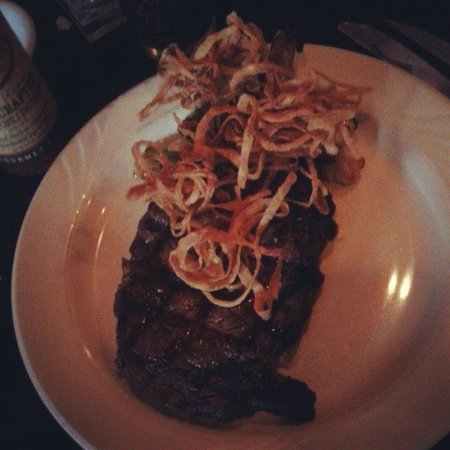 Neil Michael's Steakhouse : 16 oz Cowboy Ribeye Steak served w/veggies & onion straws