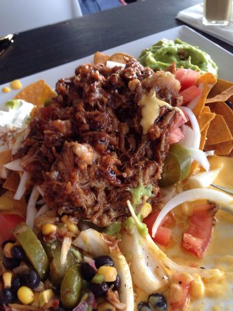 El Alambique Beach Front Bar and Grill : Nachos with pork... Worth every penny of the extra $4 for the pork!