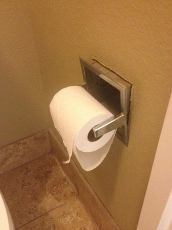 Super 8 Downtown Airport Area: Toilet paper holder is coming out of the wall