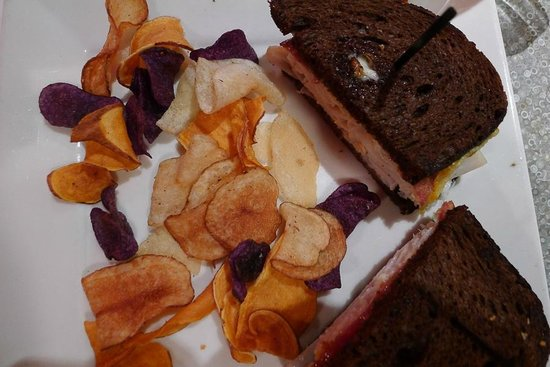 Isaac's Deli & Restaurant Incorporated: Pumpernickel sandwich and fried potato chips