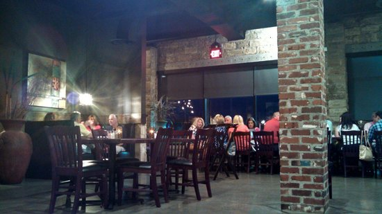 All Steak Restaurant: Exposed brick throughout the restaurant - a one time Ford dealership damaged in 2011 tornado and