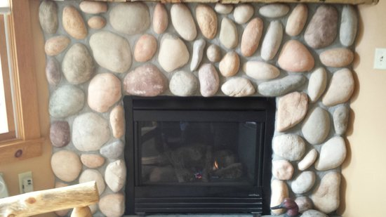 Woodstock Inn, Station & Brewery: River-stone surrounded gas fireplace