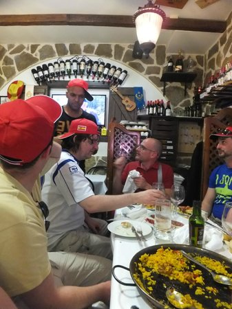 Spanish Tapas Madrid: Ending the tour with some wonderful Paella; note the fetching caps we were given as part of the