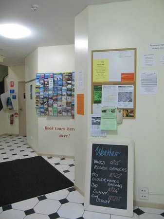 Hobart Central YHA: Interact messages & tour services board show at Main Entrance