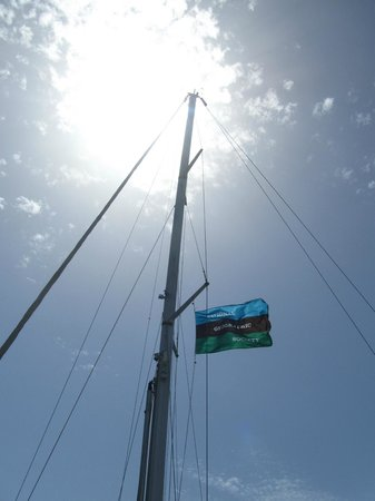 Naxos Sailing Tours: National Geographic Flag on Annabella...