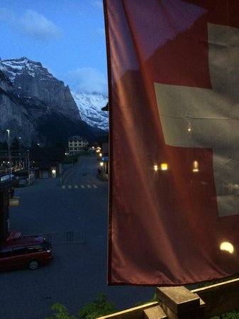 Hotel Steinbock: View at night from our balcony with the Swiss flag